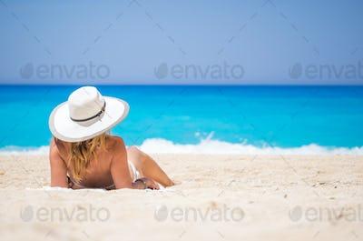 WOman on The famous Navagio Shipwreck beach in Zakynthos island
