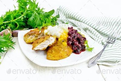 Turkey breast with cranberry sauce on light board
