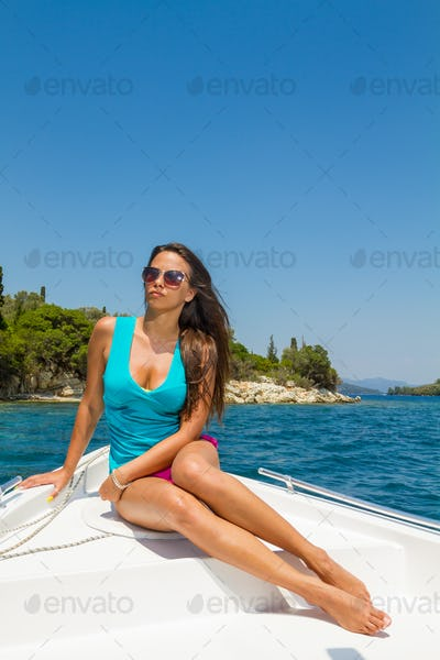 young girl on a motor boat