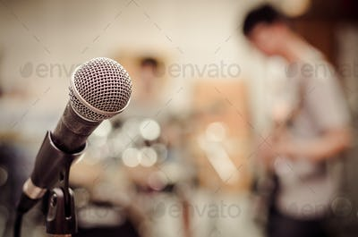 Close up of microphone on musician blurred background,vintage tone