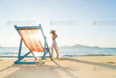 Young woman lying on sun lounger near the sea