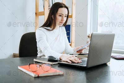 Remote Accounting Finance Jobs. Online Accounting Solution. Candid portrait of female accountant