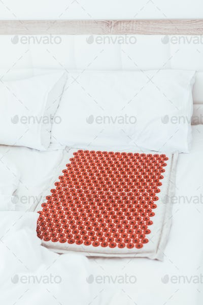 Acupuncture mat in the bed