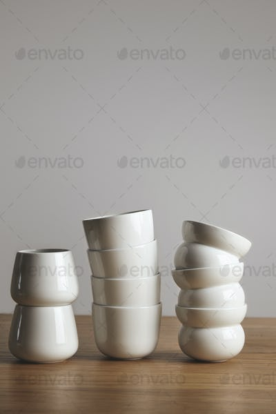 Mix of different coffee cups on table