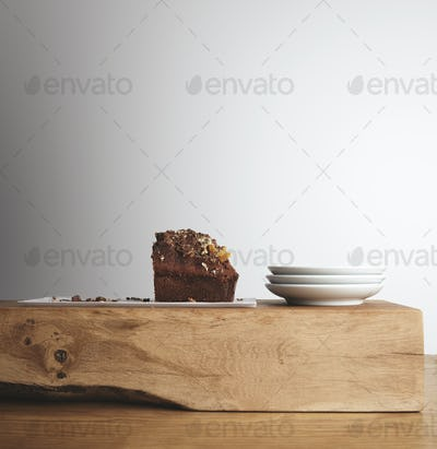 Piece of cake and tea dishes on wooden brick