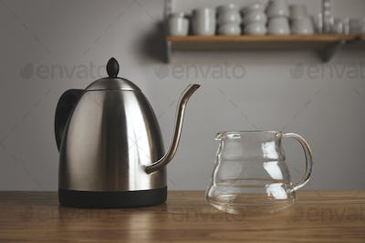 Modern teapot with transparent coffee pot on table