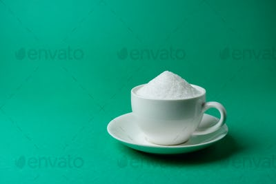 Cup full of sugar, too much, overeating