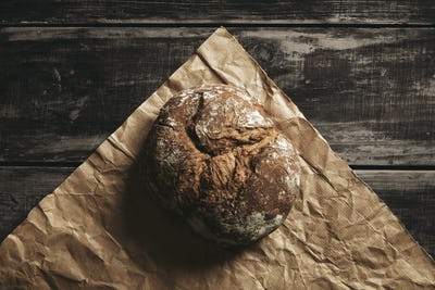 rye whole grain round bread on brown craft paper