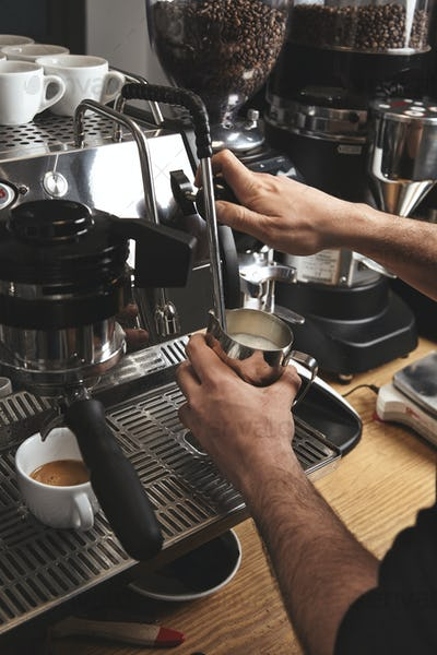 Barista preparing coffee on big italian machine