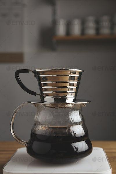 side of transparent chrome drip coffee maker