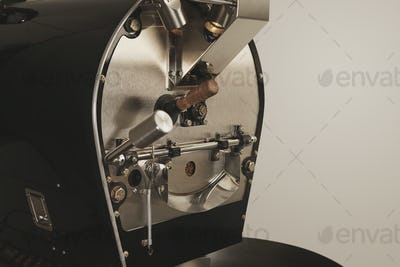 Best professional coffee roasting machine at work closeup