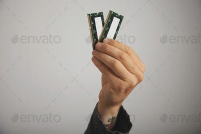 Man's hand holding RAM