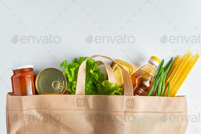 Foodstuffs on a white background. The minimum set of products.
