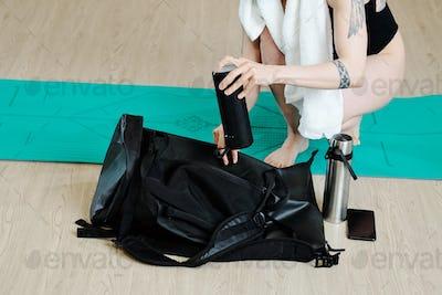 Woman packing gym bag