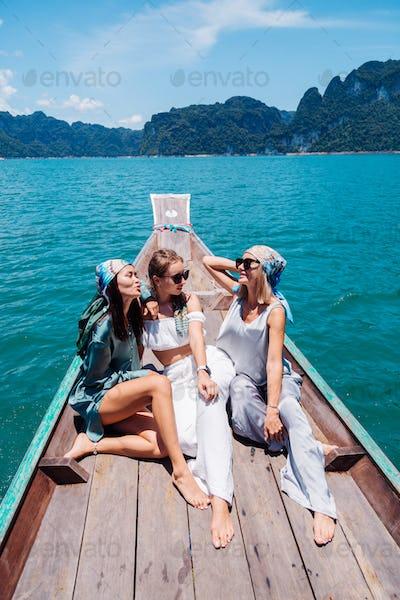 Three woman tourists friends travel around Khao Sok national park