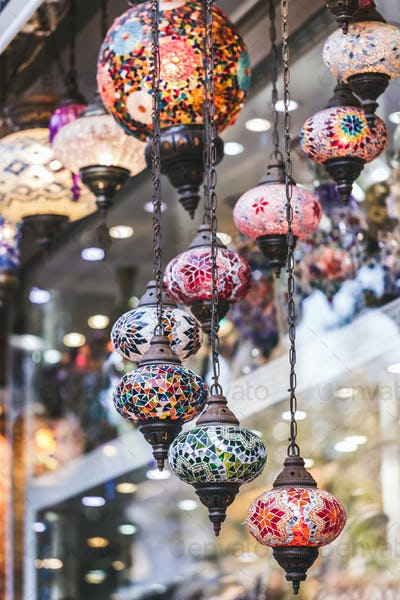Beautiful traditional handmade turkish lamps in souvenir shop. Mosaic of colored glass close up