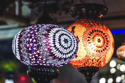 Amazing traditional handmade turkish lamps in souvenir shop. Mosaic of colored glass.