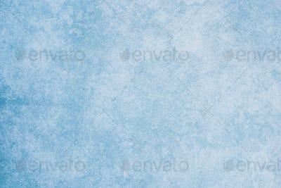blue textured paper background.