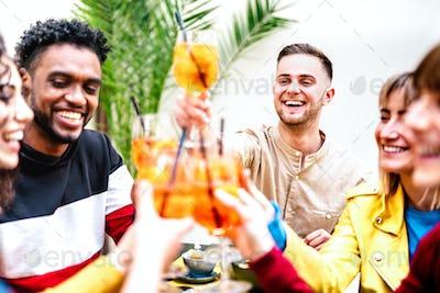 People toasting spritz at cocktail bar restaurant