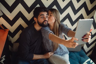 Couple making funny selfie.