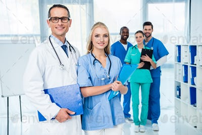 group of multiethnic doctors in clinic looking at camera