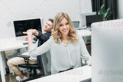 business partners giving high five at modern open space office