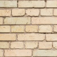 Old wall with broken bricks background