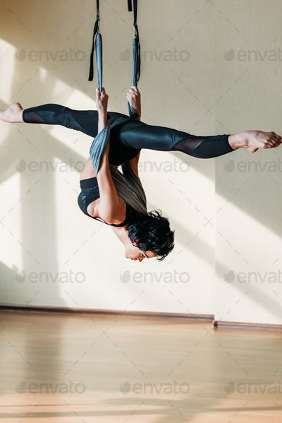 young attractive woman practicing fly yoga