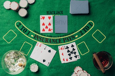 Gambling concept with cards and chips on casino table