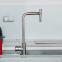 dishwashing sponges near water tap in kitchen