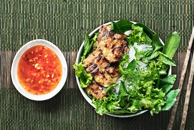 Vietnamese Rice Noodles with Grilled Pork and fresh vegetables and Chilli Sauce