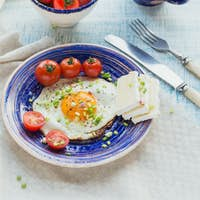 Coffee Cup, One Egg, Cheese and Cherry Tomatoes for Healthy Breakfast