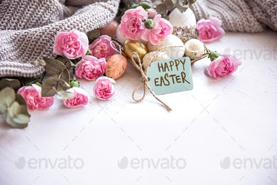 Festive composition Happy Easter with eggs, flowers and knitted element copy space.