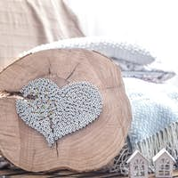Heart on a wooden background in the interior of the room