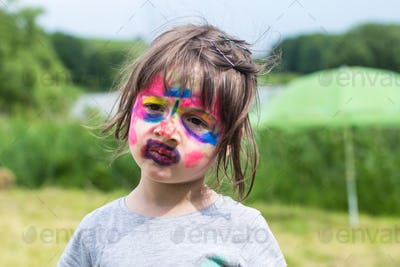 Girl with face art painting like tiger.