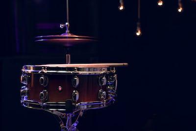 Snare drum on dark blurred background close up.