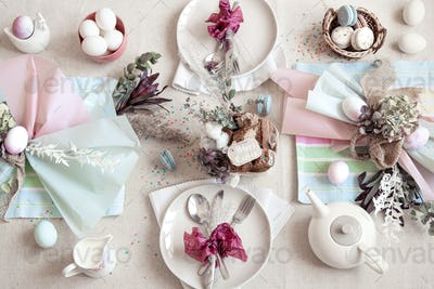 Easter dinner table setting and decor top view.