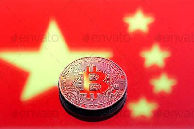 Coins Bitcoin, against the background of the Chinese flag.