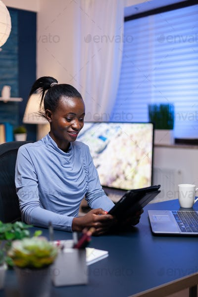African business woman checking emails