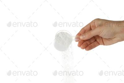 Female hand pouring washing powder, isolated on white background