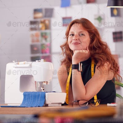 Portrait Of Smiling Female Student Or Business Owner Working In Fashion Using Sewing Machine