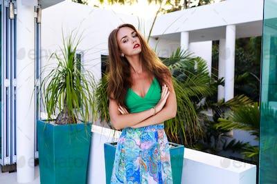 Summer outdoor fashion portrait of stunning brunette woman