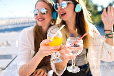 Outdoor  fanny portrait of two sister beat  friends girl having fun