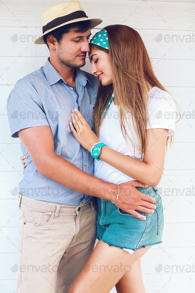 Lifestyle portrait of young sensual happy couple