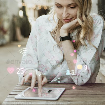Happy woman using social media on a tablet