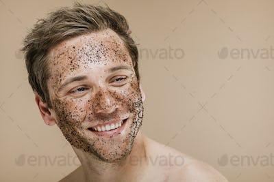Happy man scrubbing his face