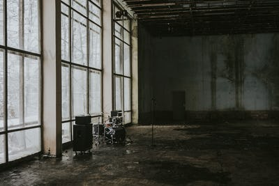 Empty industrial building setup for a music video shoot