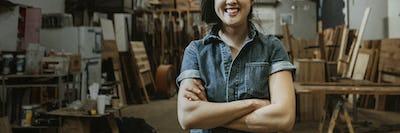 Professional female carpenter posing