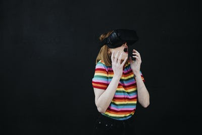 Bewildered woman wearing a VR headset