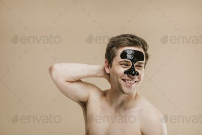 Portrait of a man wearing black pore mask